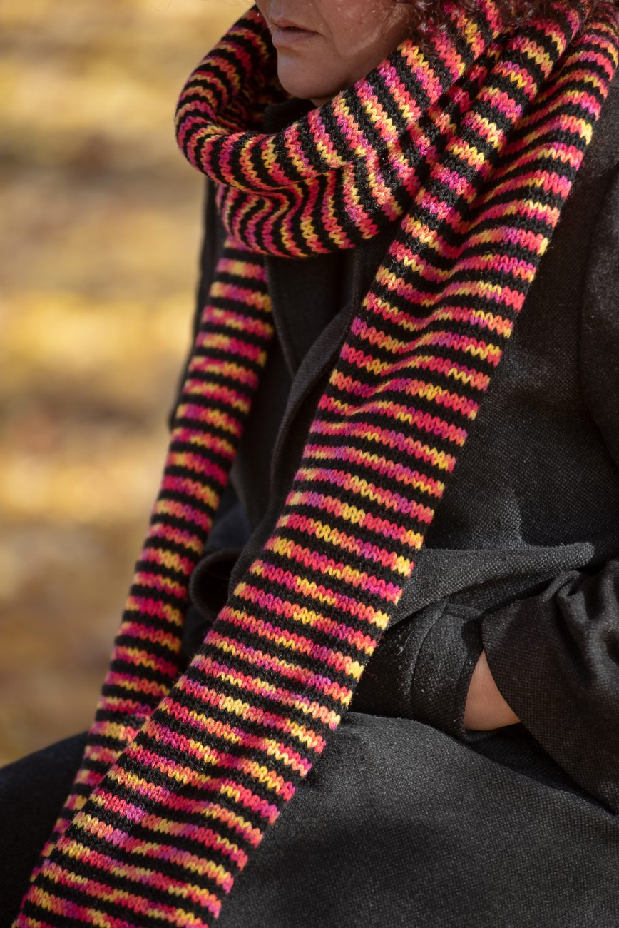 Close up of a woman with a knitted scarf