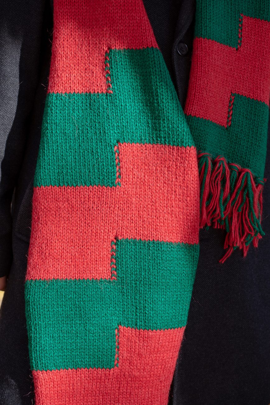 Close up of a knitted scarf in red and green